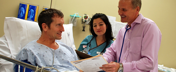 James Hakert, M.D. and nurse with patient